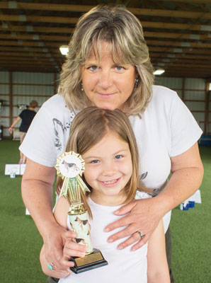 Ali Brown and daughter, Cyan, after Cyan wins her C-WAGS Rally level one title.